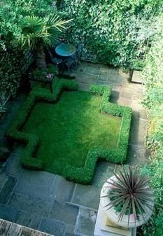 Garden with formal layout, box, lawn, hedge, paving and furniture. South side of house leading from porch to west.