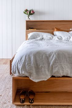 Ultimate storage solution - our custom Bookshelf Drawer Bed features 4 drawers in the platform base and a bookshelf bedhead. Handmade from solid locally sourced Australian hardwood. Styled with matching side tables and Bed Threads linen. Timber Furniture, Pallet Furniture, Home Furniture, Furniture Ideas, Bed Headboard Storage, Headboards For Beds, Bookshelf Headboard, Blue Glass Tile, Custom Bookshelves