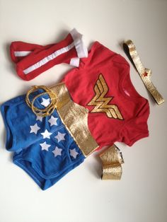 wonder woman costume. I want to find one of these for Hero!! Maybe put some black leggings under it?