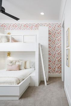 Lovely white and pink girls' bedroom is fitted with shiplap built in bunk-beds dressed in soft white and pink bedding accented with French burlap pillows and lit by antique brass sconces. Bunk Beds For Girls Room, Bunk Bed Rooms, Bunk Beds Built In, Cool Bunk Beds, Little Girl Rooms, Kid Beds, Girls Bedroom, Bedroom Ideas, Built In Beds For Kids