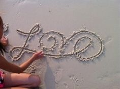 cute way to write love without picking up your pen- good idea for a scrapbook page