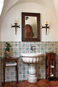 THOUGHTFUL REPRODUCTION | Thad went to great lengths to produce the kind of crafted details that confer a sense of authenticity. Hand-painted tiles and a marble basin are hallmarks of Mediterranean Revival style. The geometric tiles are fromAnn Sacks.