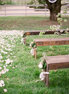 Vintage Wood Pews with Spring Floral Decor | Julie Paisley Photography | http://heyweddinglady.com/southern-spring-blossom-wedding-inspiration/