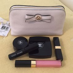 """Coach Chalk Turnlock Bow Cosmetic Case/Clutch New with tag. This gorgeous chalk textured leather cosmetic case with pretty bow detail could also be used as a clutch. Measures approx. 6.75""""L x 3.5""""W x 3.75""""H. Interior has slip pocket. Extras in photo not included. Coach Bags Cosmetic Bags & Cases"""