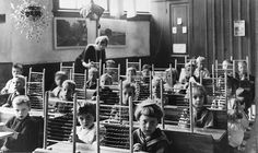 Pupils with counting-frames in classroom, about 1930. Romania