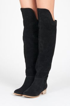 These boots were made for walkin' - in style. Faux suede that's perfectly slouchy and over-the-knee front cuff are what our boot dreams are made of, delivered