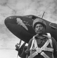 "1945: A Gurkha paratrooper in front of a plane with a drawing labelled ""Gravel Gertie"", apparently. Rangoon - Found via The Passion of Former Days"