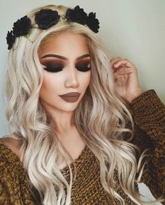 Dark smokey eye makeup, contour and browny-nude lipstick, finished with a black flower crown