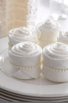 super cute napkins - roll up like cupcakes and place a strand of pearls around them. so sweet!