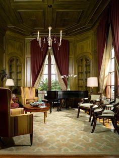 Warm wood, french doors, gorgeous furnshings.