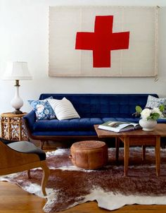 Royal Blue couch!  this is the colour I need to recover my old retro couch, it has lovely dark wood too so will look perfect.  Love! Father Rabbit's Blog.