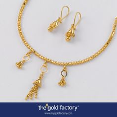 The cutest little mini-necklace, with matched half-jhumkas, epitomizes the Gold Factory ethic : fabulous designs at the lowest possible weight. This adorable set has great detailing ; notice how the chains in the centrepiece convert to a ball for the earrings. It's stuff like that that makes it all so special. Otherwise, why Gold Factory ?!  Everything handmade in 22K hallmarked gold.  Necklace weight 6 gm and price Rs. 21,500/- Earring weight 2 gm and price Rs. 7300/-