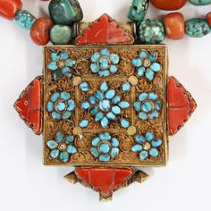 Tibetan Buddhist Gau Amulet, Tibet, gold turquoise and coral.