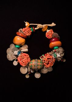 20th-century necklace of silver, coral, enamel, glass, coins, shell, cotton, plastic, buttons from Draa Valley, Morocco   ADAC