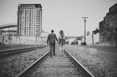 Train tracks  Holiday Photo Shoot ❤ ️Beau Bradley #herveleger #christmascard #holidaycard #engagmentshoot #unique #couplesshoot #creative #holidayphotography #fun #creativeholidayphotography #photography #christmas #couples #sunset #family #photography #beauandnadia #cozy #blanketscarf #christmaslights #bradleys #mr&mrs #traintracks #urban