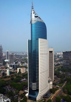 """bautyofworld:"""" Wisma Indonesia Wisma 46 is a 262 m tall (architectural height) skyscraper located in the Kota BNI-Maybank complex at Jalan Jenderal Sudirman in Central Jakarta, Indonesia. The 48 storey office tower was completed in 1996 under. Office Building Architecture, Dubai Architecture, Modern Architecture Design, Building Facade, Facade Design, Beautiful Architecture, Building Design, Chinese Architecture, Future Buildings"""