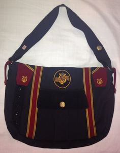 """""""ISU Band Bag"""" Helene Ducas Viall ('67 & '70) and Aimee Viall ('97 & '01) made two identical bags from two 1940's ISU band uniforms they found at a garage sale. Both Aimee and Helene play in the ISU Alumni Pep Band, and carry their piccolos in these bags. The bags won a white ribbon at the 2013 Iowa State Fair."""