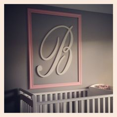 Initial in frame for twin girl nursery.
