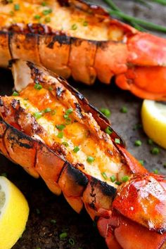 GRILLED LOBSTER TAILS WITH SRIRACHA BUTTER. 16 Crowd-Pleasing Grilled Fish and Seafood Recipes #purewow #recipe #summer #grilling #fish #cooking #food #outdoor #seafood #fishrecipes #grillingrecipes #grilledfish #easydinners #easyrecipes #healthyrecipes #lobster #seafoodrecipes