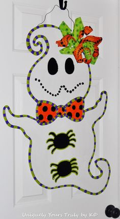 Check out this item in my Etsy shop https://www.etsy.com/listing/213051028/wood-ghost-door-hanger