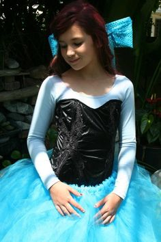 Home made costume. diy tutu, Light blue leotard, cheap black corset, glue-glunned fabric bow, and red spray paint :) . The Ariel Costume <3