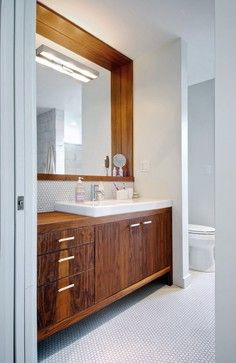 The mirror above is recessed to accommodate a small shelf above the sink. - contemporary - bathroom - Andrew Snow Photography
