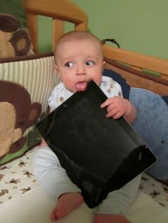 Babies With iPads. Far too adorable for words.
