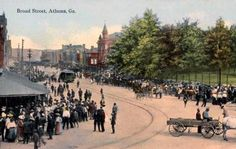 Photo from an early 1900s postcard, showing townspeople, businesses and a trolley - Athens, Georgia, US