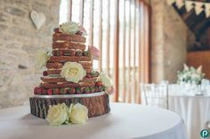 I was Rebecca and Ashley's wedding photographer at their Dorset country wedding in August last year and if you looking for wedding cake ideas, here's a fabulous example of a cake design and rustic wedding cake. It was a victoria sponge wedding cake, with fresh strawberries and cream oozing from all sides! It made my mouth water…