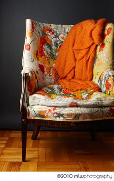 i am guessing but this chair seems antique with a newly upholstered fabric, very floral, very pretty, very diy and vintage