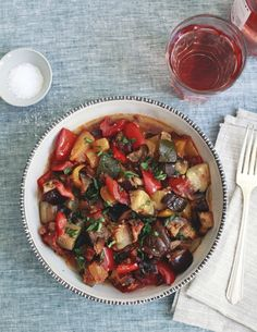 Don't put your slow cooker away just because it's summer! This healthy Slow-Cooker Ratatouille Recipe is an easy way to eat more vegetables, and it won't make your kitchen hot. For the first of many summer crockpot meals, you'll need: onions, eggplant, zucchini, summer squash, bell peppers, tomatoes, garlic, tomato paste, and basil