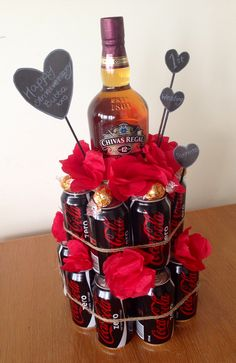 Perfect gift to give a male, alcohol tier with cola cans & paper roses