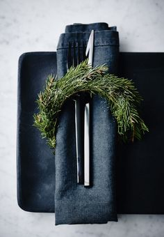 Pretty Christmas napkin decoration with a spruce branch at the table.                                                                                                                                                                                 More