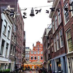 Shoefiti in alley by Bloemenmarkt (gloating flower market) in Amsterdam.