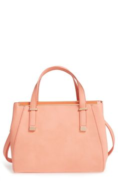 A compact look with plenty of room, this structured faux-leather satchel in peach features an interior that makes organizing a breeze.