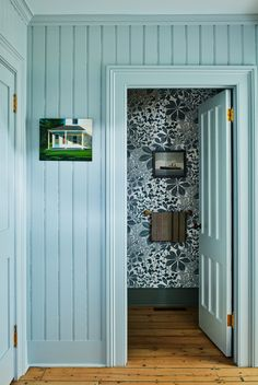 The pantry is painted Farrow & Ball's pale-blue Skylight and leads to a powder room finished with Chestnut Leaves wallpaper from Marthe Armitage. Funky Bathroom, Bathroom Floor Tiles, Decor Interior Design, Interior Decorating, Floor Sitting, Wall Molding, Family Memories, Making Memories, Level Homes