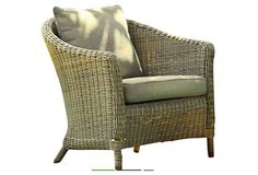 Love the unexpected sage green hue of this rattan club chair.