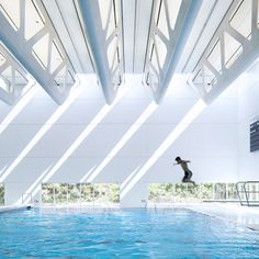 Bing Thom Architects has completed a community swimming pool building in suburban Vancouver, with a roof made from a series of giant trusses and skylights