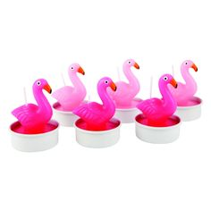 Holiday in your home: Let's all pretend we're in the Caribbean with these flamingo tea-lights. If you're not going away this summer, a few well-chosen accessories will lend a cheery holiday vibe to your home