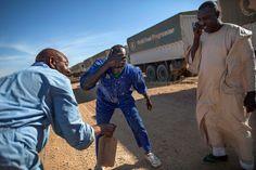 10 February 2014. Shangil Tobaya: (center) Abdurrahim Mohamed, a World Food Programme (WFP) truck driver, washes his face during a break near Shangil Tobaya, North Darfur, coming from El Fasher. Photo by Albert Gonzalez Farran, UNAMID - www.albertgonzalez.net