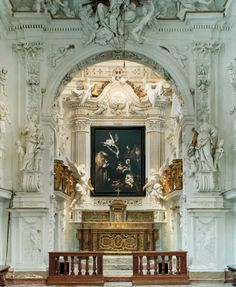 sculptures by Giacomo Serpotta surround a photograph of a stolen Caravaggio in the San Lorenzo oratory in Palermo, Sicily. photographed by Domingo Milella for the New York Times magazine.