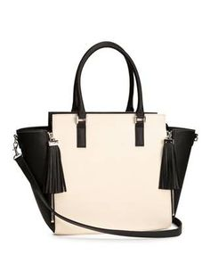 :: Two times a lady :: Want to lighten up your accessories for spring but still look totally polished? We suggest this two-tone stunner. For purists, it also comes in solid black. (H&M handbag, $39.95, hm.com)