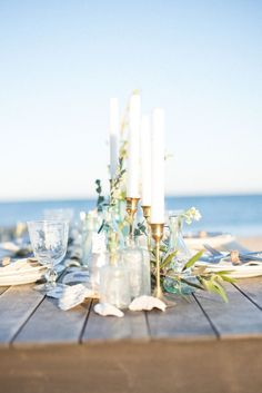 Beach tablescape with slender gold candle holders | Photo by Addie Eshelman