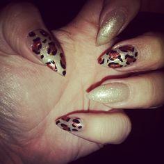 Leopard print and gold glitter stiletto nails