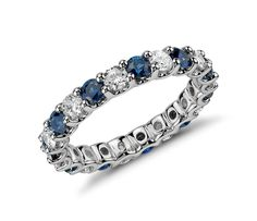 This eternity ring features round sapphires and diamonds in a shared-prong design of enduring platinum.