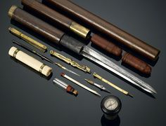 This extremely rare explorer's cane is the perfect companion for the intrepid adventurer. A small compass is set into the knob handle, while several more instruments are tucked inside the shaft, including a telescope, a bayonet, a drafting compass, pens and parchment papers, field maps, and plotting tools. An ink bottle and case are also included, completing this extraordinary cane.
