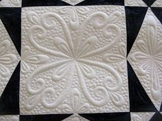 Incredible free motion quilting! This blog also has tutorials on quilting and free motion designs.