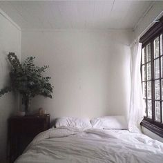 Bedroom. A Comfy bed pushed up agains a a big window for lots of natural light. My favorite place to just be.