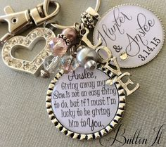 This customized key chain or necklace is a great gift to give your future daughter in law or daughter on her wedding day. It makes a great gift to give her on her wedding day before she walks down the aisle as it can nicely clip on to her bridal bouquet by clasping around the flower stem. After the wedding day, it would make a great wedding keepsake and function as a key chain. The main pendant can come with any of the quotes shown, and the accent pendant will come the names and wedding…