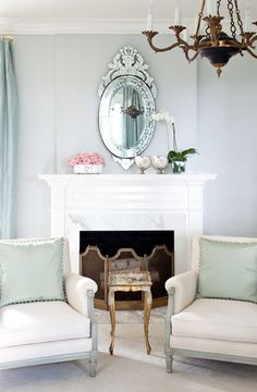 love the mirror with all the white  The chandelier and table saves the room from looking stark.